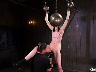 Naked bitch with hands and head round metal balls