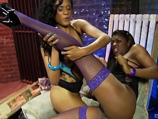 Lesbian ebony babes in fishnets masturbate together with vibrators