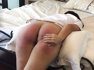 Asian slave Vanida gets a firm painful castigation on her slutty round butt.