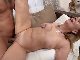 A hot bimbo granny is procurement fucked by a horny younh man