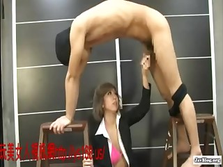 Half-naked office lady plays with a masked dude on couch