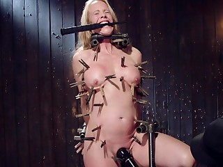 Nude busty mature damage and dominated in full clamping BDSM