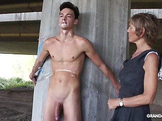 Nympho granny sucks a big bushwa be fitting of tied up naked guy