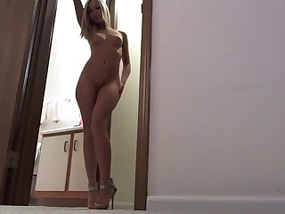 Blonde busty babe masturbating  at bottom webcam and loves it