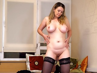 Video of busty cougar Anastasiya effectuation with her stained snatch