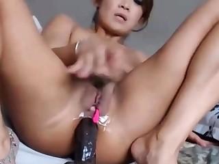 Asian Babe Riding Their way Dildo