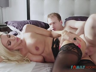 Sizzling blnde COUGAR is wearing softcore, dark-hued stocking greatest extent having fuck-a-thon with her spouse's socialize