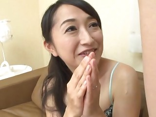 Asian mature Takita Eriko masturbates while watching a naked dude